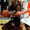 Beverly:<br /> Salem's Davonte Holloway gets ready to shoot for a basket as Beverly's Ty Suggs tries to squash his move during the Salem at Beverly boys basketball game.<br /> Photo by Ken Yuszkus/Salem News, Tuesday, January 3, 2011.
