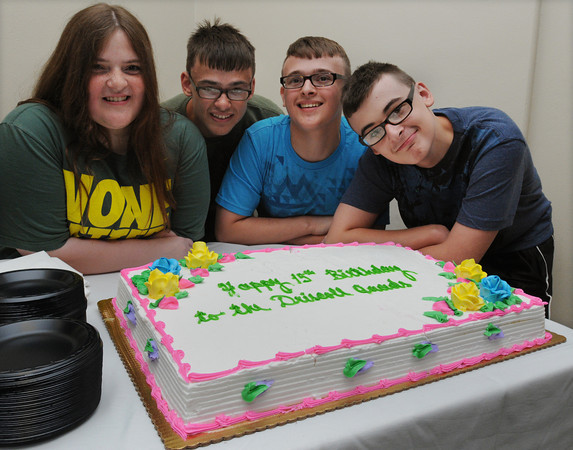 Beverly:<br /> From left, quadruplets Emma, Riley, Killian, and Cullen Driscoll stand near the large cake for their 15th birthday party held at Beverly Hospital. The quadruplets had their very own cakes as well.<br /> Photo by Ken Yuszkus/Salem News, Friday, July 13,  2012.