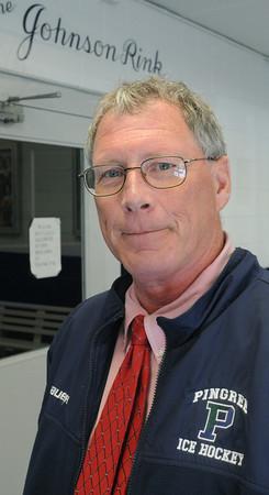 Hamilton:<br /> Buddy Taft, the Pingree hockey coach, is retiring as coach after many seasons.<br /> Photo by Ken Yuszkus/Salem News, Monday,  April 2, 2012.