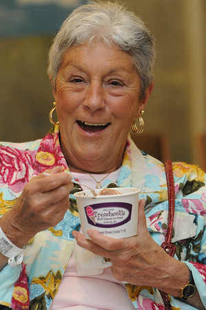 Danvers:<br /> Julie McNamara of Danvers enjoys a free ice cream sundae from Tom Gould at the Mass. General, North Shore Cancer Center.<br /> Photo by Ken Yuszkus/Salem News, Monday, June 13, 2011.