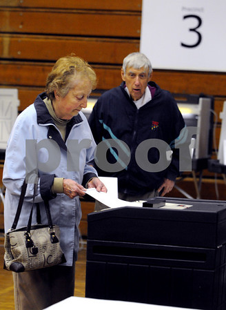 Danvers:<br /> Anne and Ray Gargam place their ballots into the ballot box at the polls during the Danvers Town Election at the high school.<br /> Photo by Ken Yuszkus/Salem News, Tuesday May 5, 2009.