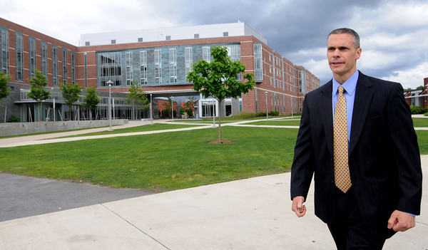 Salem:<br /> Gene Labonte is Salem State's new chief of campus police. He is walking in front of Marsh Hall on campus.<br /> Photo by Ken Yuszkus/Salem News, Tuesday, June 26, 2012.