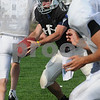 Danvers:<br /> Gregg Ladd, as quarterback, passes off the ball behind the line of scrimmage during practice at Danvers High School.<br /> Photo by Ken Yuszkus/Salem News, Tuesday September 10, 2008