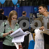 Salem:<br /> Stephanie Read and Peter Jervinis, both from Beverly and are seniors at Salem State College, roam through the booths at the job fair at the college.<br /> Photo by Ken Yuszkus/Salem News, Monday, March 30, 2009.