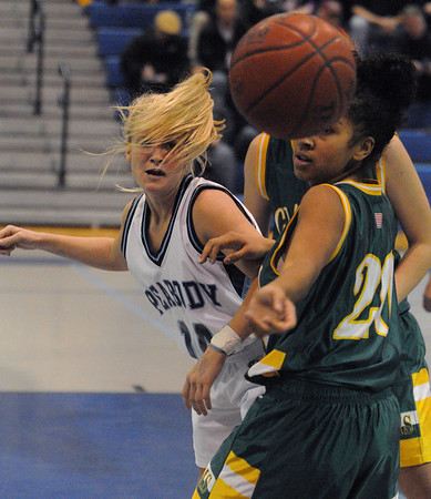 Peabody:<br /> Peabody's Katie Brunelle, left, watches the ball that got away from her under the basket during the Peabody High girls basketball game vs. Lynn Classical at Peabody.<br /> Photo by Ken Yuszkus/Salem,  News, Tuesday,  December 14, 2010.