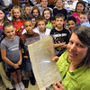 Peabody:<br /> Michelle Eugenio, 4th grade teacher, holds the document from the Revolutionary War era which was found in her classroom. Her class is standing behind her.<br /> Photo by Ken Yuszkus/Salem News, Tuesday, June 1, 2010.