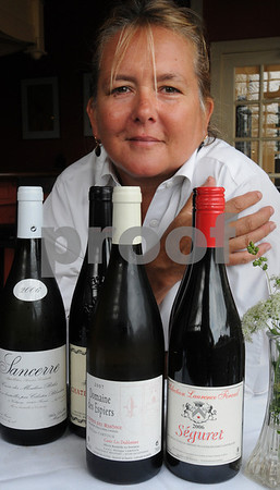 Salem:<br /> Kate Hammond, cook at the Grapevine Restaurant, with some red and white French wine that the restaurant has on its menu.<br /> Photo by Ken Yuszkus/Salem News, Monday, August 10, 2009.