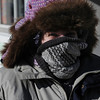 Salem:<br /> Mary Kelley of Salem, is bundled up against the frigid temperatures while walking on Washington Street on Monday morning. <br /> Photo by Ken Yuszkus/Salem News, Monday, January 24, 2011.