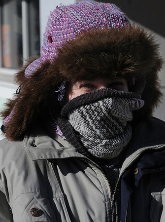 Salem:<br /> Mary Kelley of Salem, is bundled up against the frigid temperatures while walking on Washington Street on Monday morning. <br /> Photo by Ken Yuszkus/Salem News, Monday, January 24, 2011.