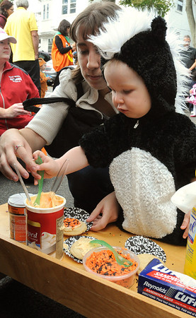 Salem:<br /> Amy Magowan helps her son Tyler Vallois, 15 months old, both of Lowell, make cookies at the North Shore Infant and Toddler Program. Cerebral Palsy Association. of Eastern Mass had a Halloween celebration for children in its Salem program on Wednesday.<br /> Photo by Ken Yuszkus/Salem News, Wednesday, October 12, 2011.