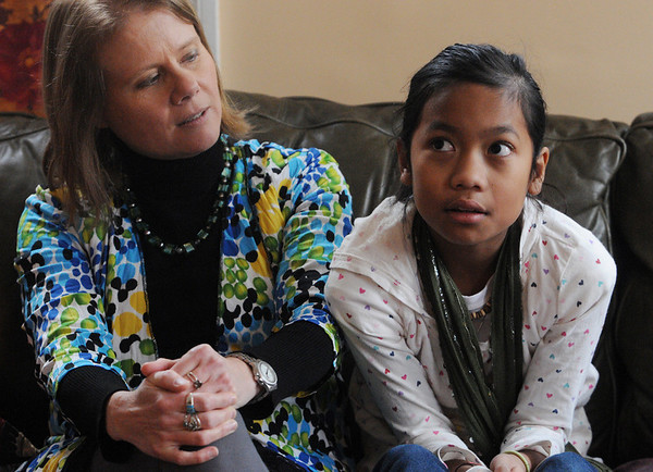 Salem;<br /> Jean Monahan, left, and her adopted daughter Lilah are taking Lilah's first trip to her native country, Cambodia. <br /> Photo by Ken Yuszkus/Salem,  News, Wednesday,  December 15, 2010.