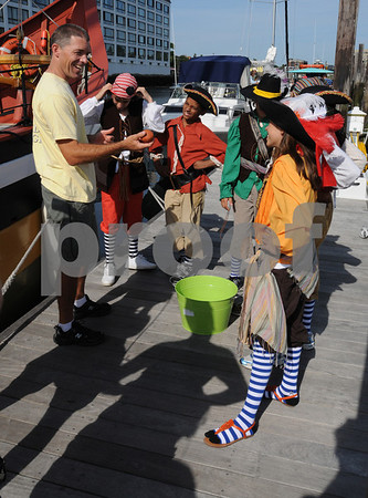 """Salem:<br /> """"Fetch With Ruff Ruffman"""" is a nationaly telecast children's show on public television. The actors listen to Mike Rutstein, owner, operator, and captain of the schooner Fame before boarding the schooner at Pickering Wharf during a shoot for a pirate episode.<br /> Photo by Ken Yuszkus/Salem News, Thursday, August 6, 2009."""