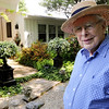 Danvers:<br /> John Burbidge in his garden in the back of his home. Cile and John Burbidge's Garden will be included on the Danvers Garden Tour this year.<br /> Photo by Ken Yuszkus/Salem News, Monday, June 20, 2011.