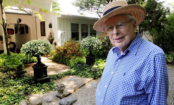 Danvers:<br /> John Burbidge in his garden in the back of his home. Cile and John Burbidge's Garden will be included on the Danvers Garden Tour this year.<br /> Photo by Ken Yuszkus/Salem News, Monday, June 20, 2011.
