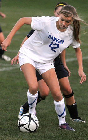 Danvers:<br /> Danvers' Meaghan McCarriston keeps possession of the ball during the Andover at Danvers girls soccer game at Deering Stadium.<br /> Photo by Ken Yuszkus/The Salem News, Monday, September 10, 2012.