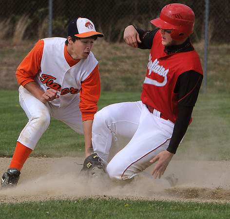Ipswich:<br /> Masco's Evan Bunker safely steals second base, with Ipswich's Dylan Cain covering second at the Masconomet at Ipswich baseball game.<br /> Photo by Ken Yuszkus/Salem News, Thursday, April 29, 2010.