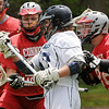 Hamilton:<br /> Hamilton-Wenham's Eliott Burr is crowded by Bishop Connelly's players at the net during the Bishop Connolly at Hamilton-Wenham boys Lacrosse East Division 3 state tournament opening game.<br /> Photo by Ken Yuszkus/Salem News, Friday, June 3, 2011.