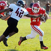 Topsfield:<br /> Masco's Mike Tivinis gets away from North Andover's Ahamdi Ogwuru at the North Andover at Masconomet football game on Thanksgiving Day.<br /> Photo by Ken Yuszkus/Salem News, Thursday, November 24, 2011.