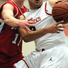 Salem:<br /> Salem's Antonio Reyes keeps a handle on the ball despite the pressure from Burlington during the Burlington at Salem boys basketball game in first round of Division 2 North state playoffs.<br /> Photo by Ken Yuszkus/Salem News, Tuesday, March 1, 2011.