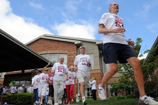 Peabody:<br /> John Wroblewski leads the pack of runners from the starting line during the Brooksby Village marathon. He was the first resident to cross the finish line.<br /> Photo by Ken Yuszkus/Salem News, Wednesday, May 23, 2012.