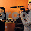 Peabody:<br /> Eliot Fisher, videographer, shoots a documentary film at Olveiras Restaurant. The film is about Brazilian immigrants in the North Shore.<br /> Photo by Ken Yuszkus/Salem News, Friday May 8, 2009.