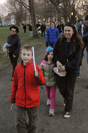 Salem:<br /> Trevor, Annabelle, and Cindy Johnson lead the group at the start of the walk. Today is World Autism Awareness Day. In Salem, people walked a lap around the common for awareness and support of those with Autism. They wore blue and wore blue glow bracelets.<br /> Photo by Ken Yuszkus/Salem News, Monday, April 2, 2012.