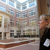Beverly:<br /> Jo Broderick is in awe struck by the veiw of the courtyard from one of the glass doorways on the first floor. She took one of the many tours after the ribbon cutting ceremony for the new Beverly High School on Friday morning.<br /> Photo by Ken Yuszkus/Salem News,  Friday,  November 19, 2010.