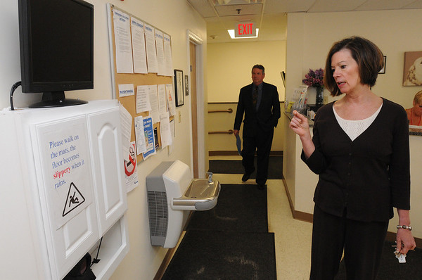 Peabody:<br /> Jayne Wilson, program director, explains the scanning device which the clients use at Community Substance Abuse Center in Peabody.<br /> Photo by Ken Yuszkus/Salem News, Wednesday, June 9, 2010.