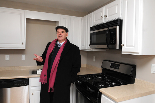 Ipswich:<br /> Thomas Bentley, housing co-ordinator for the town of Ipswich, stands in the kitchen of the new apartment at 21-23 S. Main Street.<br /> Photo by Ken Yuszkus/Salem News, Friday, January 22, 2010.