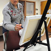 Beverly:<br /> Sharon Weir works with acrylic paint on her canvas during a painting class at the Beverly Council on Aging on Wednesday afternoon.<br /> Photo by Ken Yuszkus/Salem News, Wednesday, January 26, 2011.