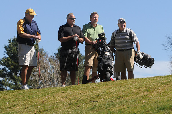 Beverly:<br /> From left, Charlie Bulger, of Beverly, Steve Polansky of Beverly, Bob Crist, of Byfield, and Dave Lops, of Beverly, play golf at the Beverly Golf & Tennis Club on Friday.<br /> Photo by Ken Yuszkus/Salem News, Friday,  March 23, 2012.