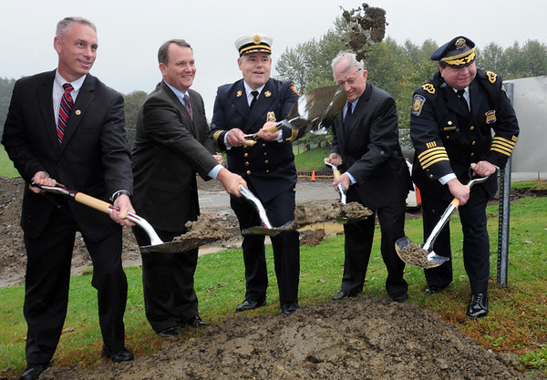 Middleton:<br /> From left, Amesbury Mayor Thatcher Keezer, Lt. Governor Timothy Murray, Topsfield Fire Chief Ron Giavannacci, Beverly Mayor Bill Scanlon, and Wenham Fire Chief Ken Walsh throw shovels of dirt at the conclusion of the Essex County Regional Emergency Communications Center ground breaking ceremony.<br /> Photo by Ken Yuszkus/Salem News, Tuesday, October 4, 2011.
