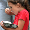 Salem:<br /> Meg Regan, 8, digs into her ice cream. The public had a chance to sample flavors from many of the North Shore's creameries, ice cream shops and restaurants. The event was part of Heritage Days.<br /> Photo by Ken Yuszkus/Salem News, Monday, August 8, 2011.