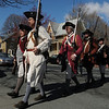 Peabody:<br /> The  Danvers Alarm List Company marches in formation across Washington Street to participate in the ceremonies honoring  the fallen soldiers from South Danvers (Peabody) at the Battle of Lexington at the start of the Revolutionary War. The ceremonies were held at the Lexington Monument on Washington Street Monday morning.<br /> Photo by Ken Yuszkus/Salem News, Monday, April 18, 2011.