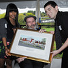 Danvers:<br /> Senate Majority Leader Fred Berry receives a framed artist drawing from Jessica Ulloa of North Shore Regional Vocational School, left, and Jake Ruotolo of the Essex Agricultural & Technical High School,  toward the end of the Essex North Shore Agricultural & Technical School groundbreaking ceremony.<br /> Photo by Ken Yuszkus/Salem News, Wednesday, May 9, 2012.