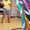 Ipswich:<br /> Sandy Noe exercises with her hula hoop during the weekly women's hula hoop session in the Senior Center in town hall. A collection of different colored hoops in the foreground frame her.<br /> Photo by Ken Yuszkus/Salem News, Monday, August 10, 2009.
