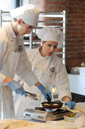 Boston:<br /> Peabody culinary students, Doug Toth, left, and Katherine Pittsley, prepare their dishes while they compete during the state Prostart competition in Boston. <br /> Photo by Ken Yuszkus/Salem News, Friday, February 11, 2011.