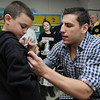 Peabody:<br /> Milan Lucic, right, signs James Grace's shirt. Milan Lucic was visiting Harolyn Fucile's and Lisa Tivnan's third-grade classes at the West Memorial School on Friday afternoon.<br /> Photo by Ken Yuszkus/Salem News, Friday,  March 9, 2012.