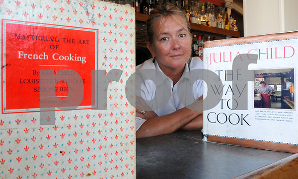 Salem:<br /> Kate Hammond, cook at the Grapevine Restaurant, has a couple of books by Julia Child.<br /> Photo by Ken Yuszkus/Salem News, Monday, August 10, 2009.