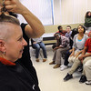 Salem:<br /> Shawn Berry, teacher at the Salem Academy Charter School, is having her head shaved by Tiffany Quirk at school, as a fundraiser for St. Baldrick's Foundation, which supports research into childhood cancers. She is having it shaved in front of the 6th, 7th, and 8th grades.<br /> Photo by Ken Yuszkus/Salem News, Tuesday, February 8, 2011.