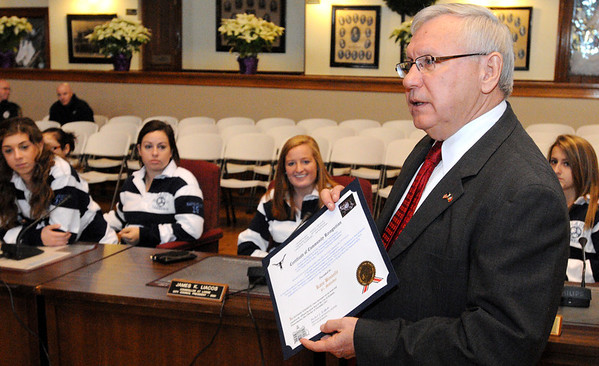 Peabody:<br /> Mayor Bonfanti honored the state champion girls soccer team and gave out citations at Peabody City Hall Thursday morning. Some of the team is in the background. Also, he gave a citation to runners Catarina Rocha and Nick Christensen.<br /> Photo by Ken Yuszkus/Salem News, Thursday, December 15, 2011.