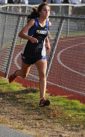 Peabody:<br /> Catarina Rocha of Peabody, finishes first in the girls  race, during the Beverly at Peabody cross country meet.<br /> Photo by Ken Yuszkus/Salem News, Tuesday,  October 26, 2010.