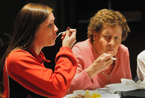 Salem:<br /> From left, Sarah Hernando, sophmore at Salem High School, a volunteer, dines with Delia Riley at the high school during the annual Thanksgiving feast for senior citizens. The culinary arts students prepared the food and it was served by high school volunteers,<br /> Photo by Ken Yuszkus/Salem News, Thursday November 19, 2009.