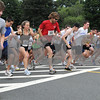Danvers:<br /> The start of the 25th annual Danvers Kiwanis Club 5-mile road race at the starting line in front of the Danvers High School.<br /> Photo by Ken Yuszkus/Salem News, Friday, June 26, 2009.
