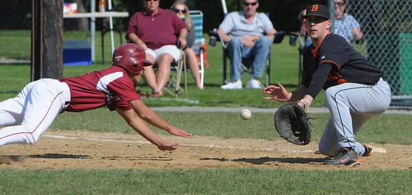 Beverly:<br /> Gloucester's Matthew Catarino dives back to 1st base safely as Beverly's Chris Mitchell waits for the pick off throw at the Gloucester at Beverly Division 2 North playoff quarterfinal baseball game.<br /> Photo by Ken Yuszkus/Salem News, Monday, June 6, 2011.