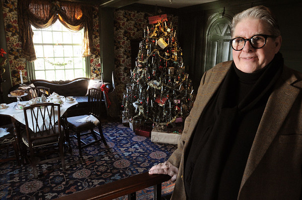 Salem:<br /> Alan Collachicco, stands in the parlor of the House of the Seven Gables. The house is decorated for Christmas in various periods of the house's existence.<br /> Photo by Ken Yuszkus/Salem News, Friday, December 16, 2011.