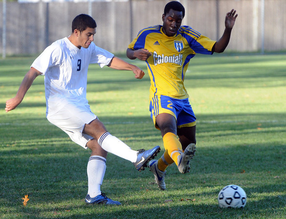 Danvers:<br /> St. John's Prep's Joseph Centofanti, left, kicks the ball upfield during the  Acton-Boxboro at St. John's Prep in Division 1 North state tournament boys soccer game.<br /> Photo by Ken Yuszkus/Salem News, Monday, November 7, 2011.