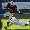 Foxboro:<br /> Brendan Flaherty gets tackled during the Beverly vs Scituate in the Division 3 Super Bowl at Gillette Stadium on Saturday.<br /> Photo by Ken Yuszkus/Salem News, Saturday, December 4, 2010.