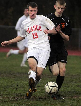 Topsfield:<br /> Masco's Derek Schleer controls the ball during the Newton North at Masconomet boys soccer Division 1 North state tournament game.<br /> Photo by Ken Yuszkus/Salem News,  Tuesday,  November 9, 2010.
