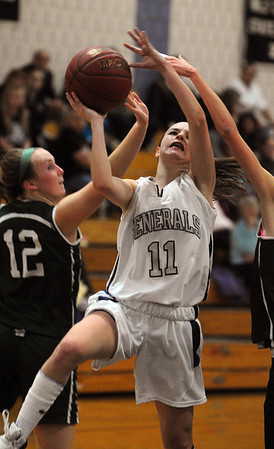 Hamilton:<br /> Hamilton-Wenham's Jen Cook shoots toward her basket as Manchester Essex' Jess Crossen, left, and Fraley Morton try to stop her shot during the Manchester Essex at Hamilton-Wenham girls basketball game.<br /> Photo by Ken Yuszkus/Salem News, Monday, February 6, 2012.